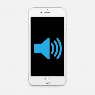 En vit telefon med et bilde på en høytaler